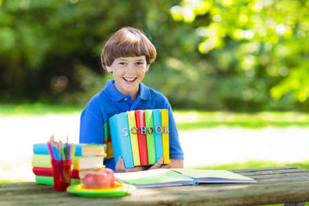 Child going back to school. Start of new school year after summer vacation. School lunch break. Little boy with backpack and books on first school day. Education for kindergarten and preschool kids.