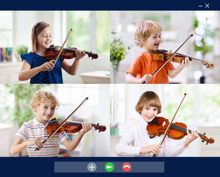 Online string orchestra rehearsal. Kids in band play violin. Child playing music. Remote learning from home. Arts for kids. Musical instrument. Video chat conference lesson. Online music tuition.
