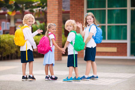 Children go back to school. Start of new school year after summer vacation. Boy and girl with backpack and books on first school day. Beginning of class. Education for kindergarten and preschool kids. 版權商用圖片