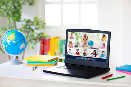 Online remote learning. Computer screen with video conference chat of student class group and teacher. Teaching and learning from home. Homeschooling during quarantine and coronavirus outbreak.