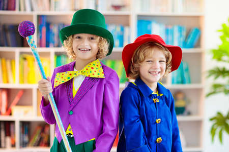 Kids in book character costume. School dress up party. English language and literature study for young children. Reading for primary school kid. Library event. Fun learning. Stock Photo