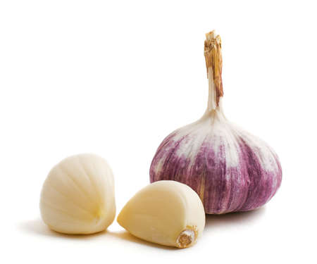two cloves and bulb of garlic isolated on a white background  photo