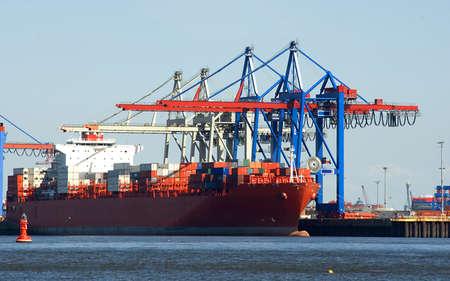 freighter at Hamburg Harbor at a loading facility  photo