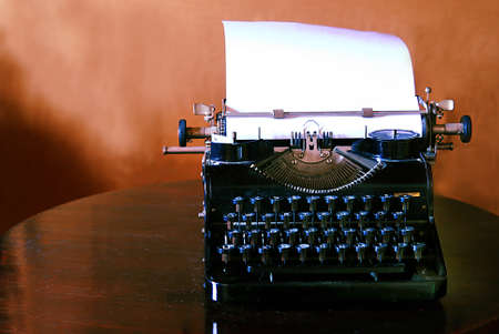 pushbuttons:  old typewriter with blank paper on a table