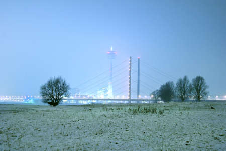 winterly: d�sseldorf media harbour and tv tower at night with winterly flood Stock Photo