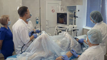 Medical team conducting surgery using endoscope