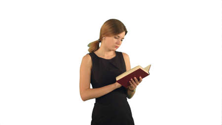 Young girl with book on laptop on white background isolated Archivio Fotografico