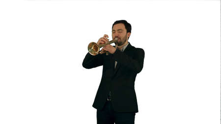 Portrait of a young man playing his Trumpet on white background isolated