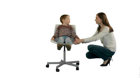 Mother and boy play game on white background isolated