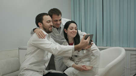 Team of doctors taking selfie all together in a medical office Archivio Fotografico