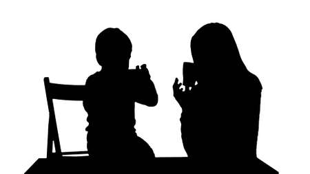Silhouette Son with his mother drinking tea Stock fotó