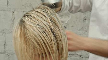 Hairdresser drying womans hair using hair dryer Zdjęcie Seryjne
