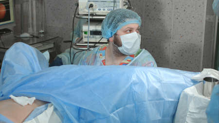 Doctor looking at the display during endoscopy surgery