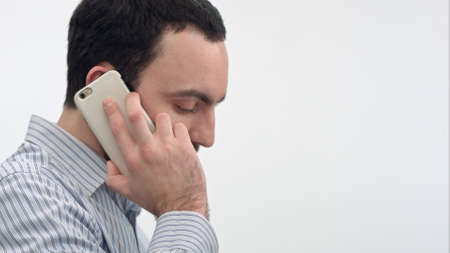 Busy office worker having phone call and passing it to female colleague