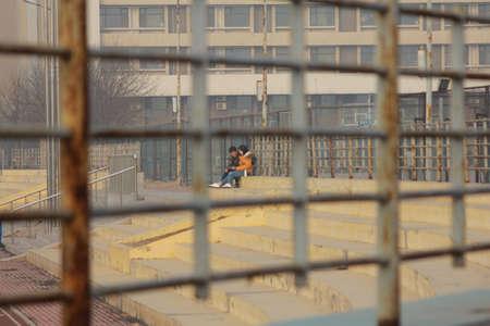 couple winter: Campus couple on winter playground