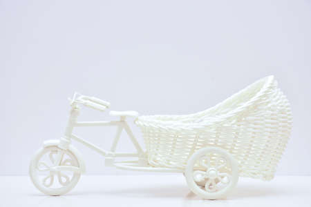 rattan bicycle toy isolated on white Stock Photo