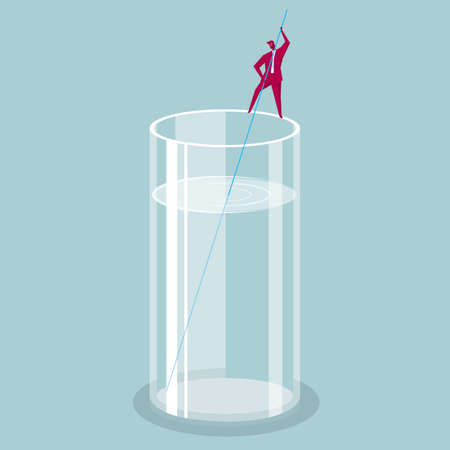 A businessman is standing at the edge of the glass to stir the drink.