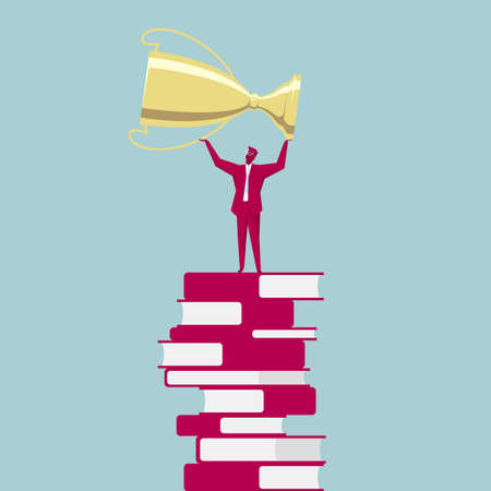 Businessman on stack of books raising a trophy. Isolated on blue background.