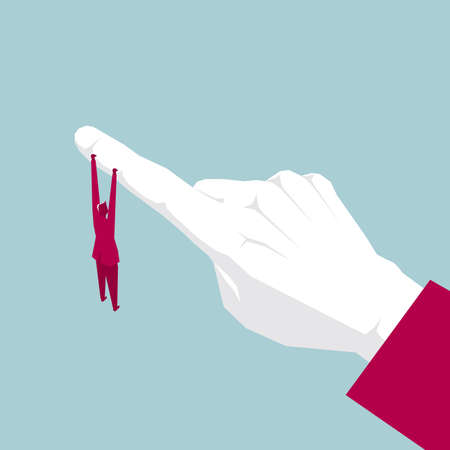 Businessman hanging onto a human finger isolated on blue background.