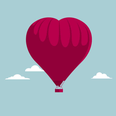 Heart shaped hot air balloon. Isolated on blue background.