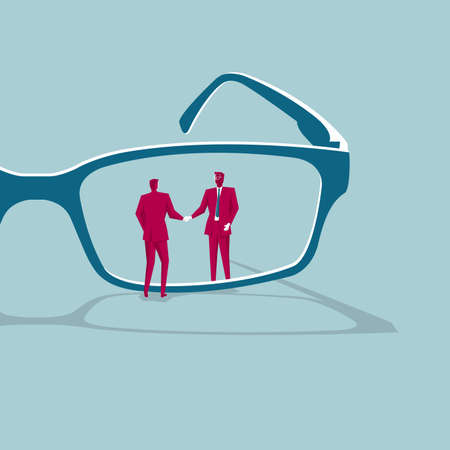 Business cooperation concept with businessmen shaking hands through a pair of glasses