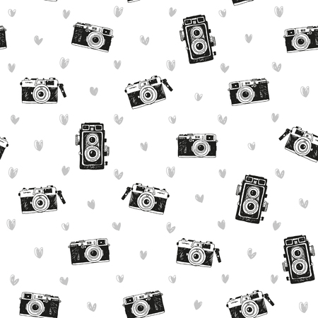 Seamless vintage background with hand drawn cameras and hearts, pattern
