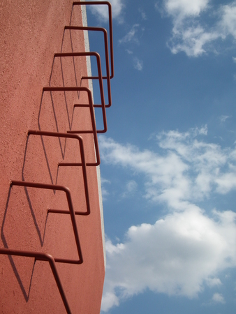 clear blue sky: Red staircase under the clear blue sky Stock Photo