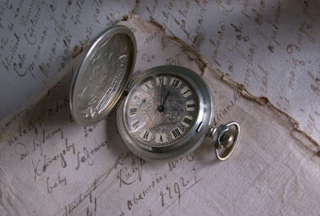 caligraphy: Old-time watch,current of time,handwritten documents,history