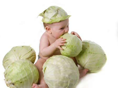 Tot plays with cabbage,acquaintance with useful vegetable Stock Photo - 1883969