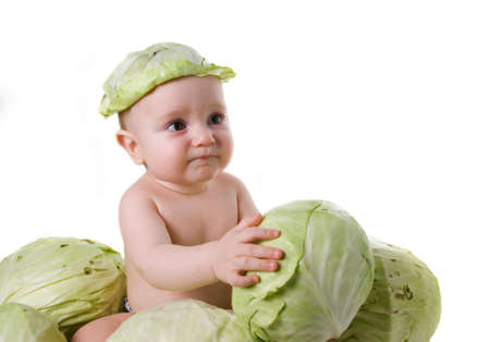 acquaintance: acquaintance with useful vegetable,small boy and cabbage Stock Photo