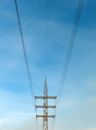 handhold: industrial provision by electricity,symmetry wire on background blue sky
