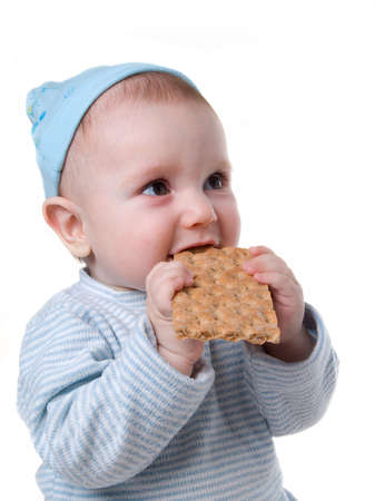 pleasing: child eats chunky cookie,tasty and pleasing meal Stock Photo