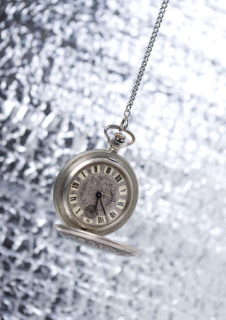 old pocket watch on brilliant background, wink to eternity Stock Photo - 2087287