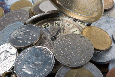 coins and old watch,money of the different countries and timeses photo