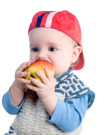 Study of  apple the by small boy, useful and tasty fruit