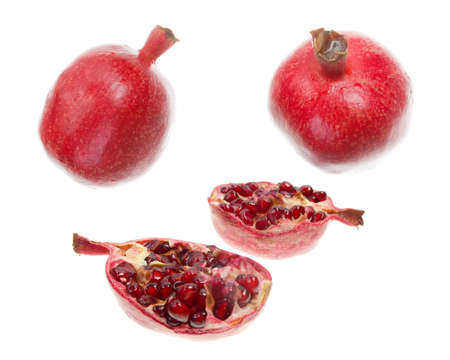 cut pomegranate with seeds around in white background photo