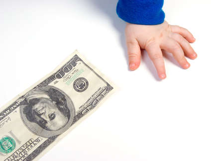 family support: Childrens hand and the dollar.family values