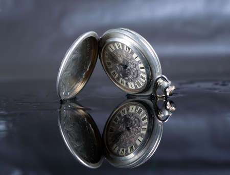old pocket watch, minute, time runs without stops photo