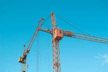 erect: Lifting crane on building of the new house.The Building technology