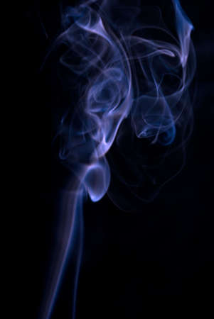 wisps: Colored smoke wisps on black background