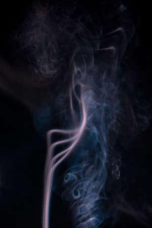 wisps: Colored smoke wisps on black background,soft patterns Stock Photo