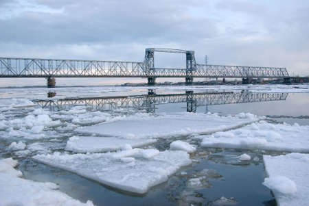 Railway bridge by springtime.Driving of ice goes On river photo