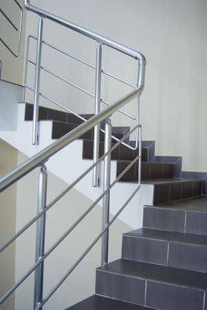 stairway enclosure with metallic stair railing within building