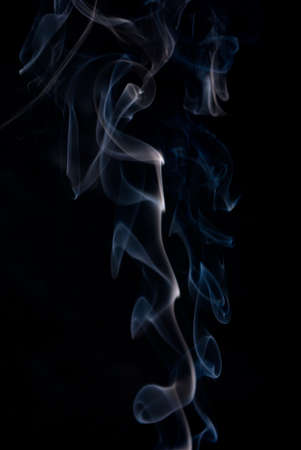 wisps: Colored smoke wisps on black background.abstract background