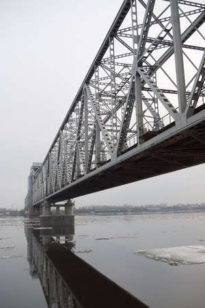 The railway bridge through the river photo