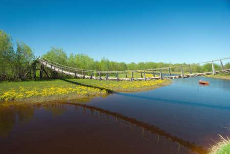 bridge over water: narrow rope pedestrian bridge over water