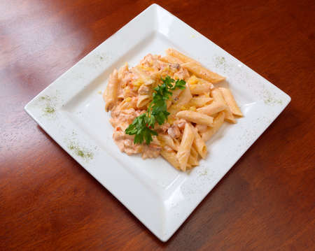 european cuisine: The Italian paste on a plate close up Stock Photo