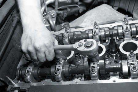 Repair of the engine. A hand with the tool. Automobile service.monochrome Stock Photo - 3681911