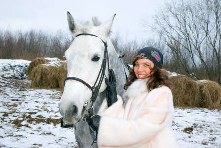 girlgypsy: beautiful girl-gypsy with horse.winter landscape Stock Photo