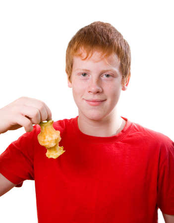leftover: redhead teenager Caucasian  wit  leftover apple .isolated on a white background.